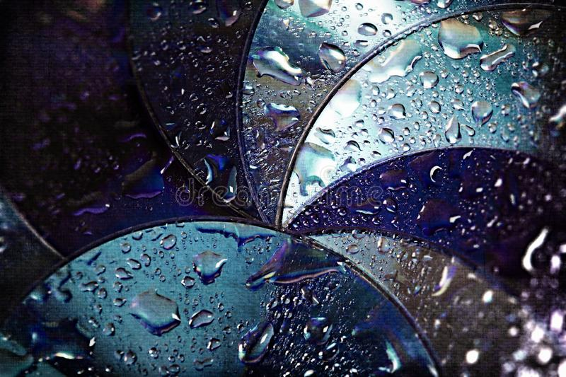 Abstract circles background. CDs SD multicolor water drops background royalty free stock photos