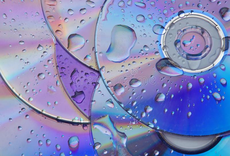 Abstract circles background. CDs SD multicolor water drops background stock photo