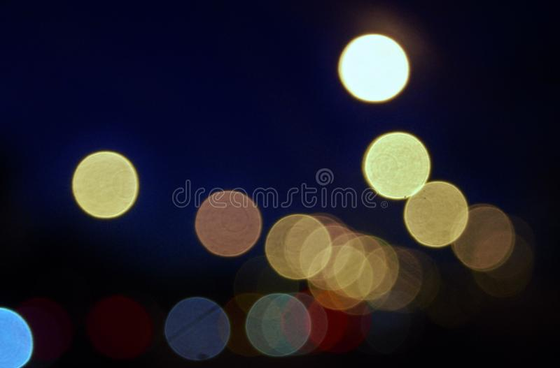 City lights abstract circular bokeh on a blue background. royalty free stock photos
