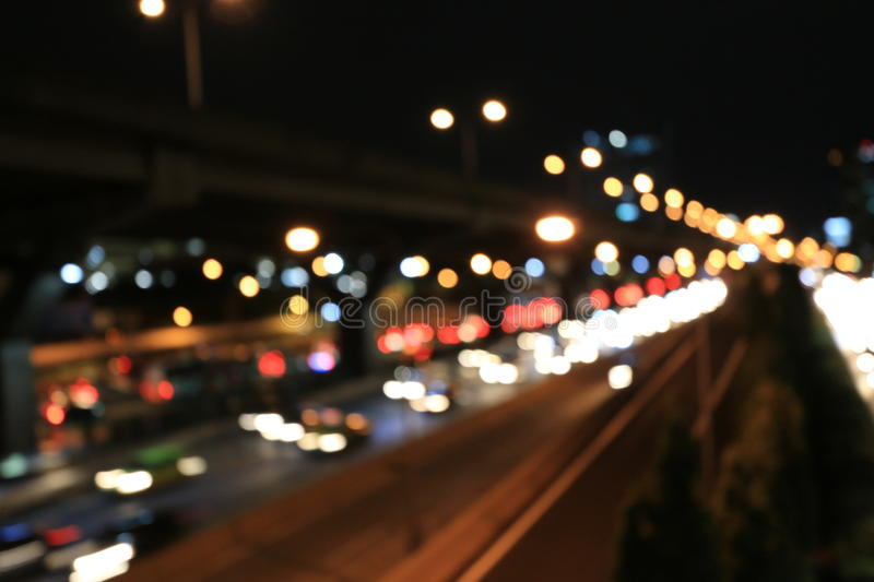 Abstract circular bokeh motion lens blur backround of city and street light or Bokeh light from car in street in night time. Bangk. Ok Expressway Thailand royalty free stock photos