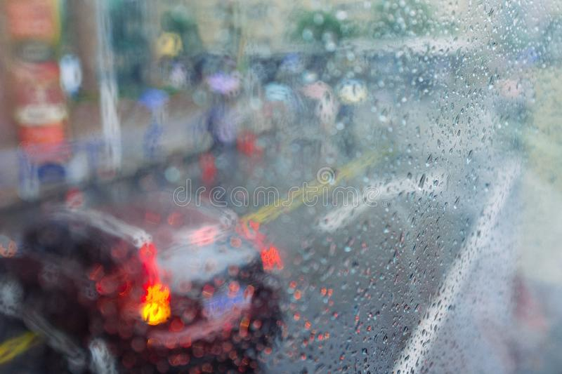 Abstract city background rain drops. Rain drops on window city street abstract background stock images