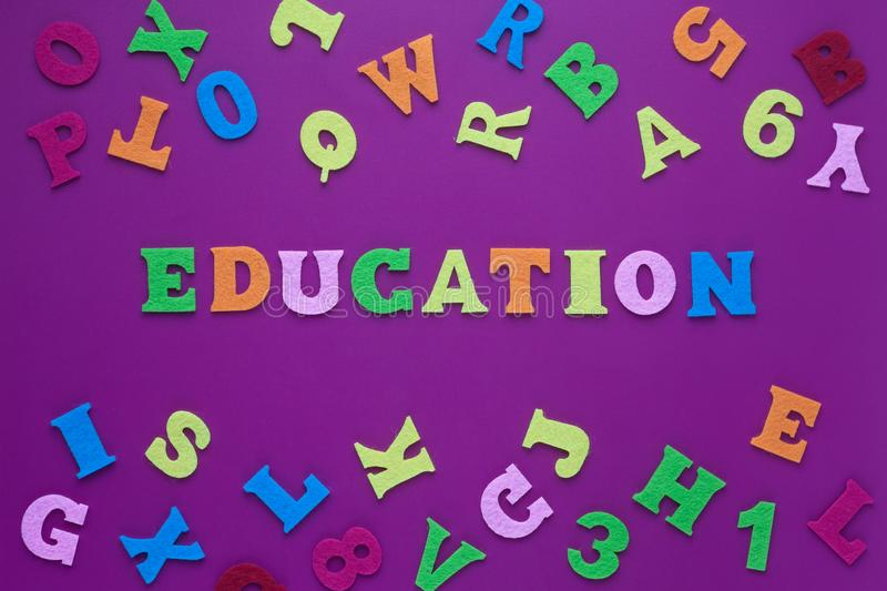 Abstract closeup of inscription education purple background for decoration design. inscription education on a purple background. With multicolored letters. A royalty free stock image