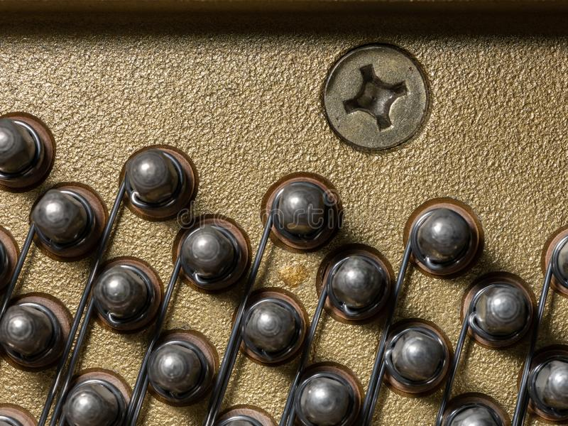 Abstract closeup of the interior of an upright piano royalty free stock images