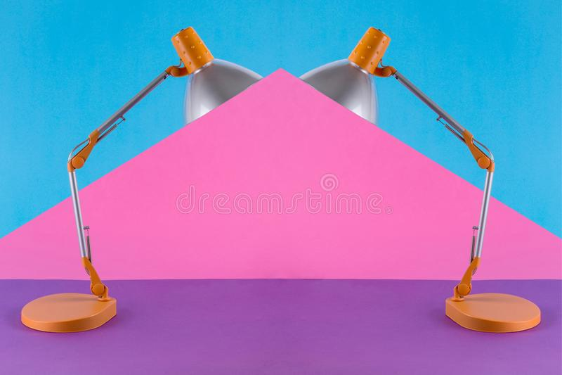 Abstract collage with table lamp. On a colored background royalty free stock image