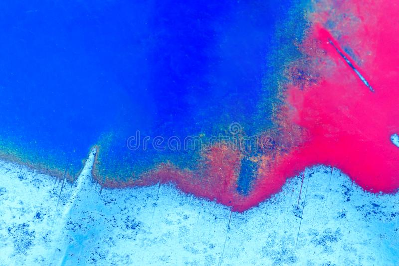 Abstract color background. The metal plate is painted red and blue. Time-polished metal stock photography