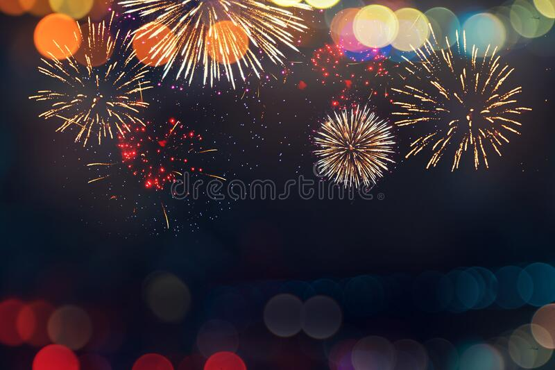 Abstract color fireworks display on dark sky background with copy space stock photos