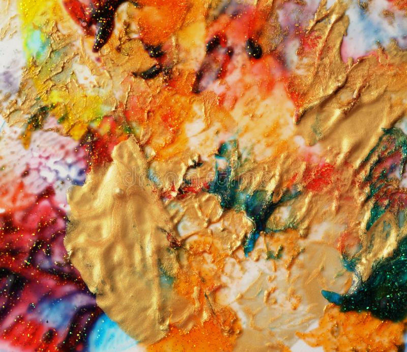 Abstract color gold background. Acrylic paint with sparkles. Colorful blots. Marble texture.  stock image