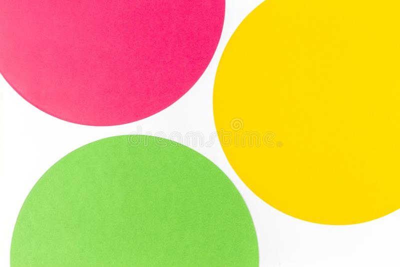 Abstract color paper background. Pastel green, yelllow and red color round circle shape geometry composition on white stock illustration