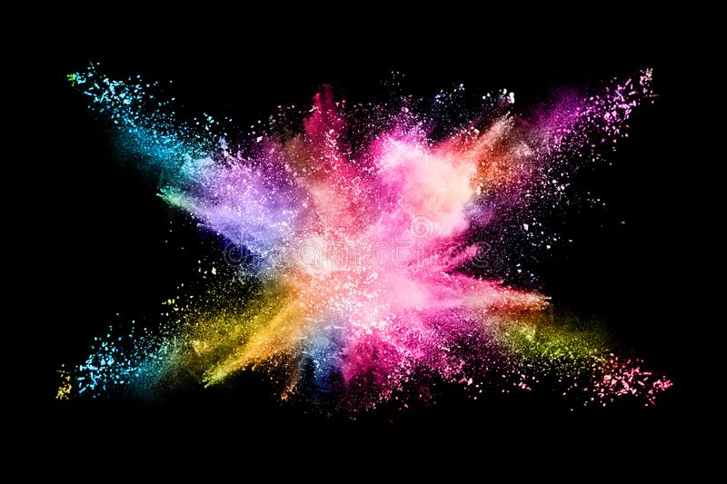 Abstract colored dust explosion on a black background. Abstract powder splatted background,Freeze motion of color powder exploding/throwing color powder stock images