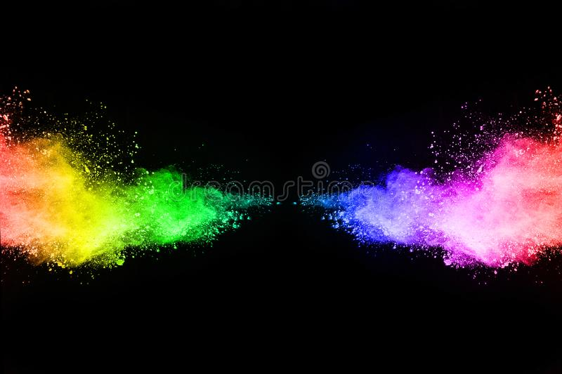 Abstract colored dust explosion on a black background. Abstract powder splatted background,Freeze motion of color powder exploding/throwing color powder royalty free stock images