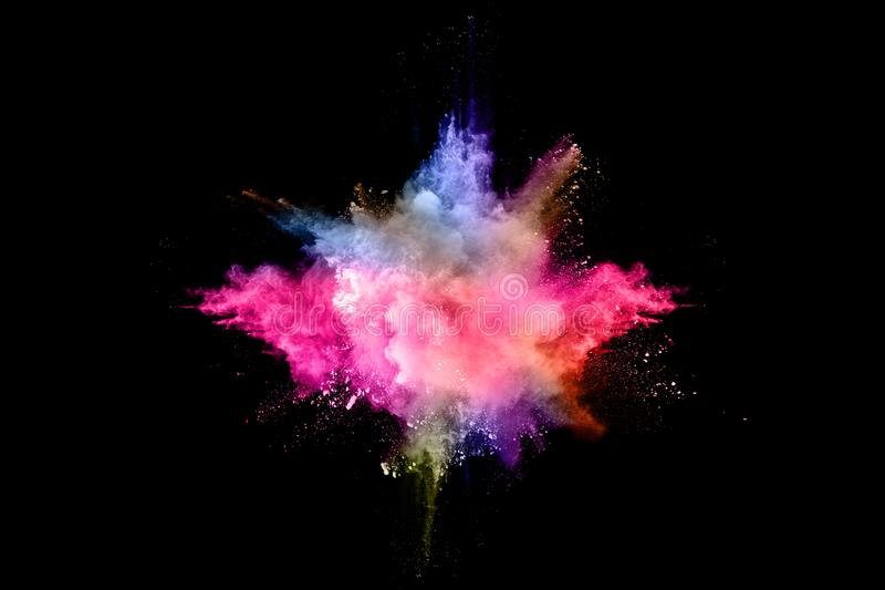 Abstract colored dust explosion on a black background. Abstract powder splatted background,Freeze motion of color powder exploding/throwing color powder royalty free stock image