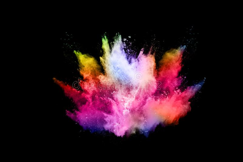 Abstract colored dust explosion on a black background. Abstract powder splatted background,Freeze motion of color powder exploding/throwing color powder royalty free stock photo