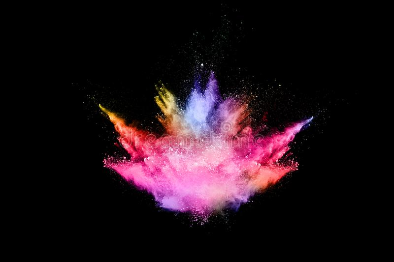 Abstract colored dust explosion on a black background. Abstract powder splatted background,Freeze motion of color powder exploding/throwing color powder royalty free stock photography