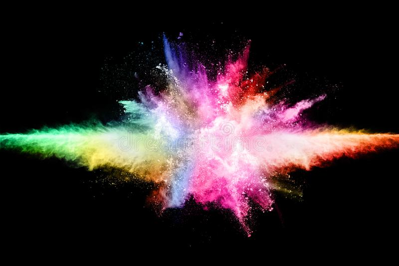 Abstract colored dust explosion on a black background. Abstract powder splatted background,Freeze motion of color powder exploding/throwing color powder stock image