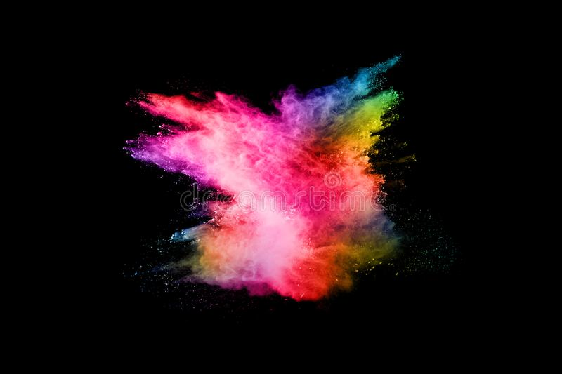 Abstract colored dust explosion on a black background. Abstract powder splatted background,Freeze motion of color powder exploding/throwing color powder royalty free stock photos
