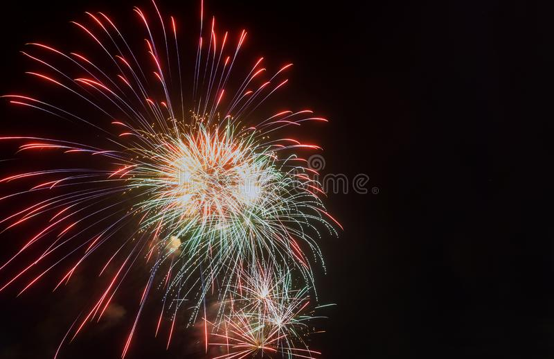 Abstract colored firework background with free space. Abstract colored beautiful firework with free space for text, fireworks, pyrotechnics, celebration stock photo