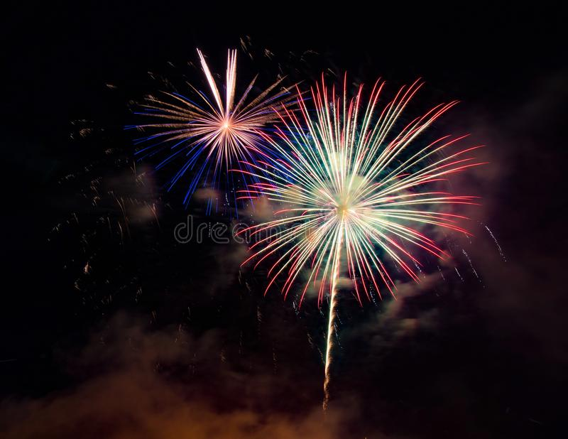 Abstract colored firework background used for overlay new year f royalty free stock photos