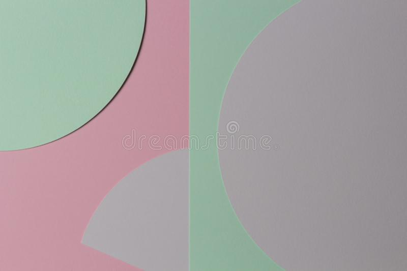 Abstract colored paper texture background. Minimal geometric shapes and lines in pastel pink, gray, light blue and green. Colours stock photography