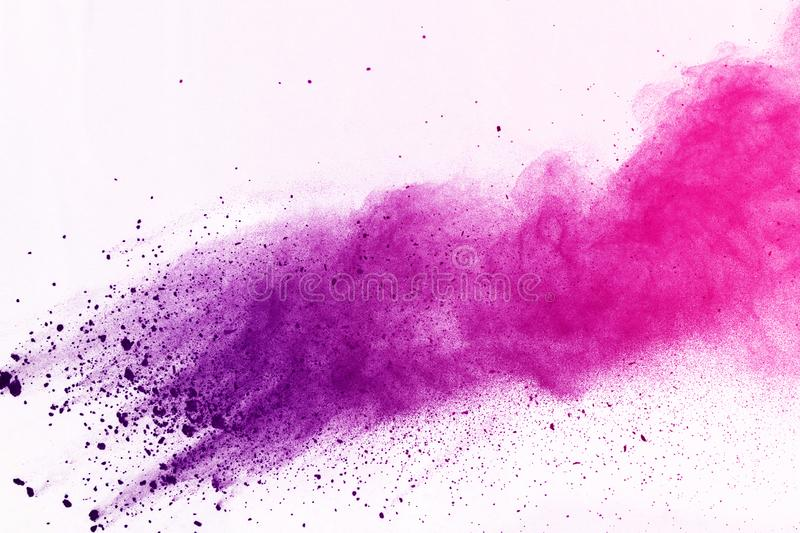 Colored powder explosion. Colore dust splatted. Abstract of colored powder explosion on white background. Multicolor powder splatted isolate. Colorful cloud royalty free stock photo