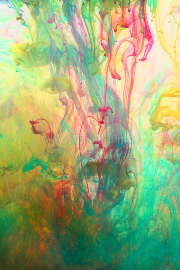Abstract colorful background. Of cyan and magenta inks mixing and diluting stock image