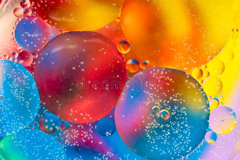Abstract colorful Background Oil in Water surface Foam of Soap with Bubbles macro shot close-up royalty free stock images