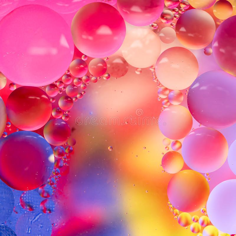 Abstract colorful Background Oil in Water surface Foam of Soap with Bubbles macro shot close-up stock images