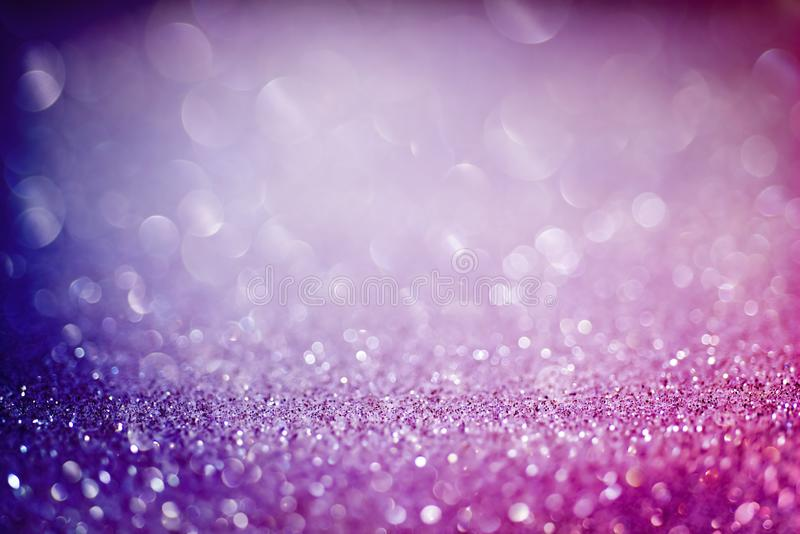 Abstract colorful background with purple and blue glittering light bubbles.  stock photo