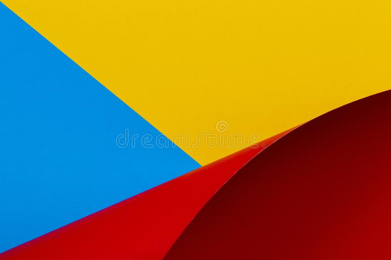 Abstract colorful background. Yellow red blue color paper in geometric shapes stock images