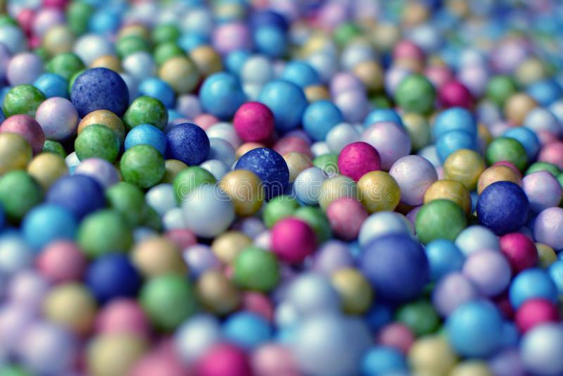 Colorful ball background made up of many small mostly blue foam balls stock photos