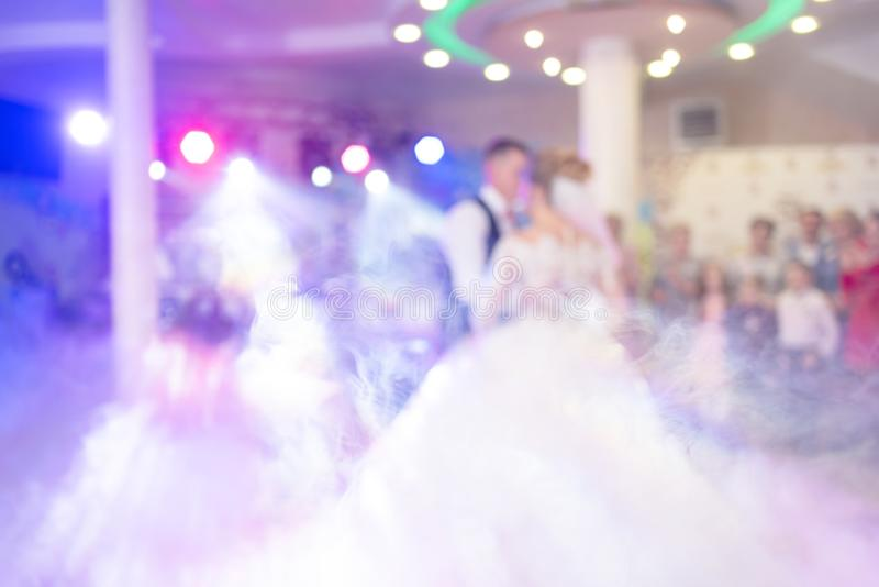 Abstract colorful blurry background, copyspace for text. Newlyweds dance their first dance. Dance is decorated with light effects stock image