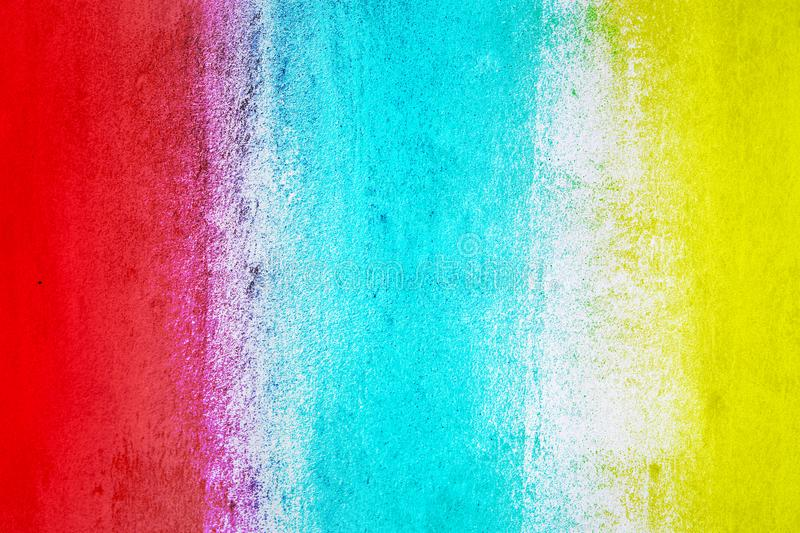 Abstract colorful cement wall texture and background. Grunge red blue and yellow painted on concrete wall. High quality picture royalty free stock photo