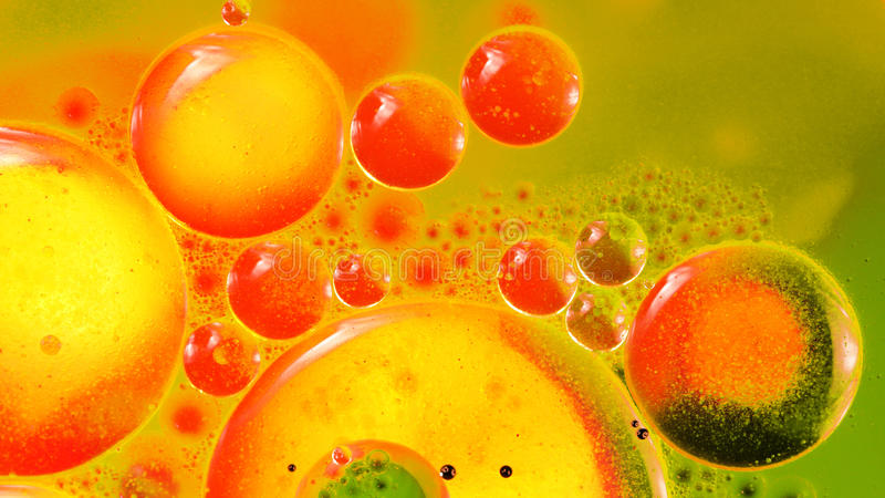 Abstract, colorful composition with oil, water and ink stock photography