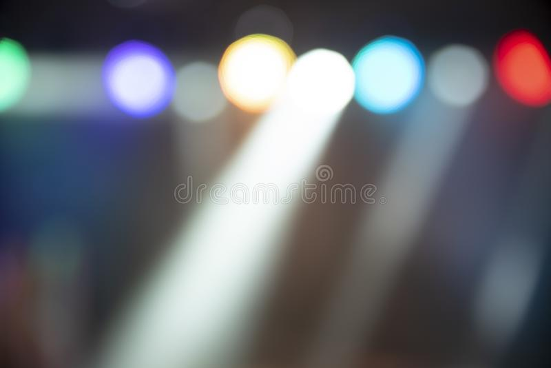 Abstract colorful defocused background, light spotlights on party royalty free stock photo