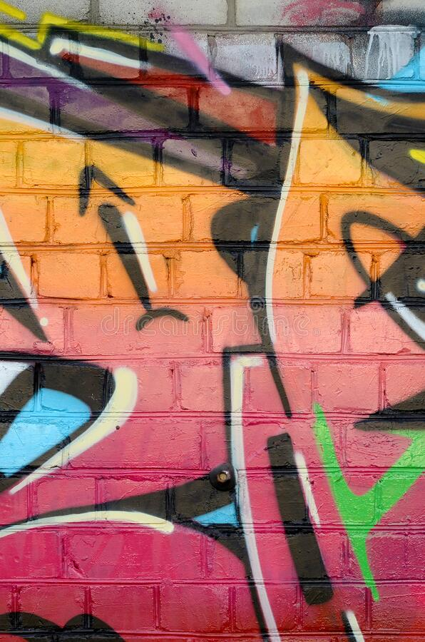 Abstract colorful fragment of graffiti paintings on old brick wall. Street-art composition with parts of wild letters and stock images