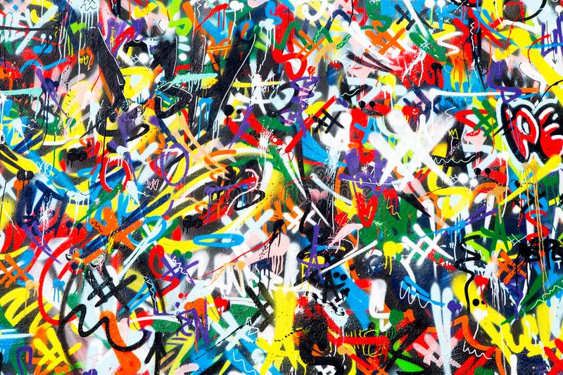 Abstract colorful graffiti wall background. Abstract colorful spray painted vandalized ghetto graffiti tagged wall background stock photo