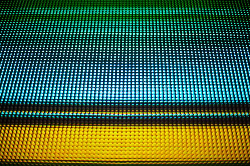 Abstract colorful parallel lines texture background, blue, green, yellow neon light strips on black backdrop, decorative ornament. Abstract colorful parallel royalty free stock image