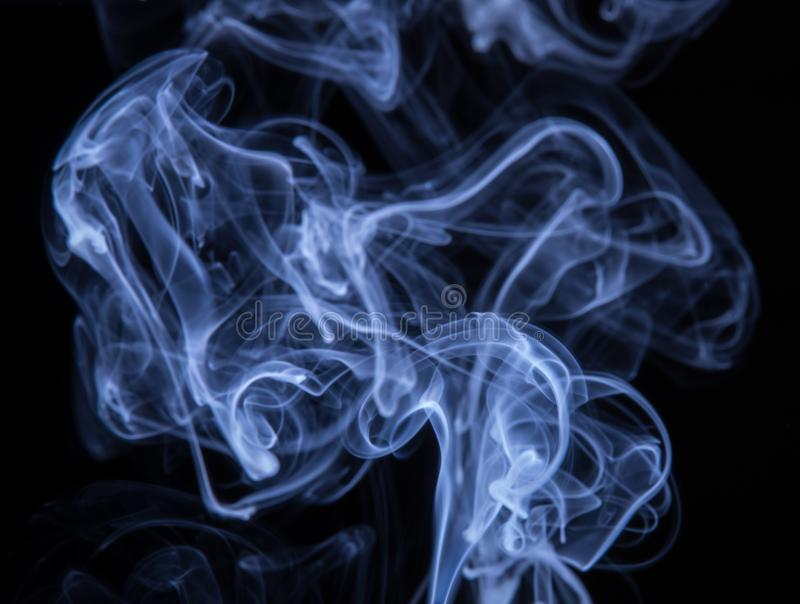 Abstract colorful smoke isolated on black background, fire design.  royalty free stock images