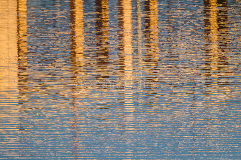 Abstract colorful water reflections of orange and blue. In Florida royalty free stock photography