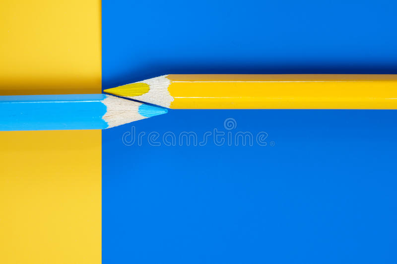 Abstract composition of blue and yellow pencils. Abstract composition of blue and yellow pencil on paper of the same colors. Back to school theme royalty free stock images