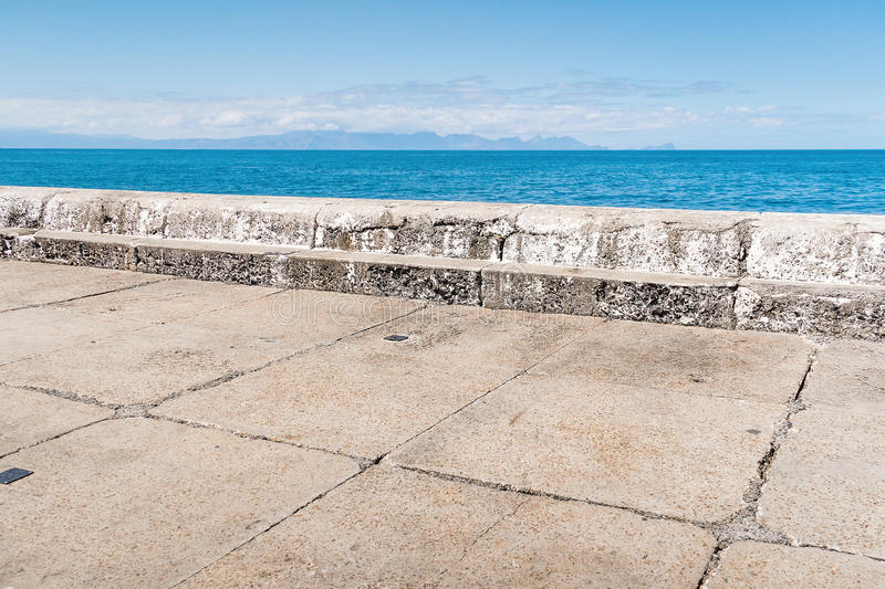 Abstract composition of harbor pier with horizon stock photography