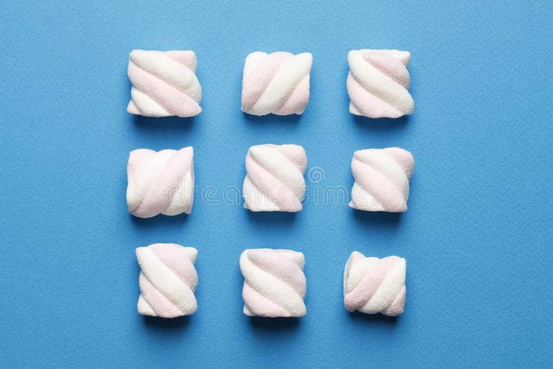 Abstract composition of marshmallows on a blue background royalty free stock photography