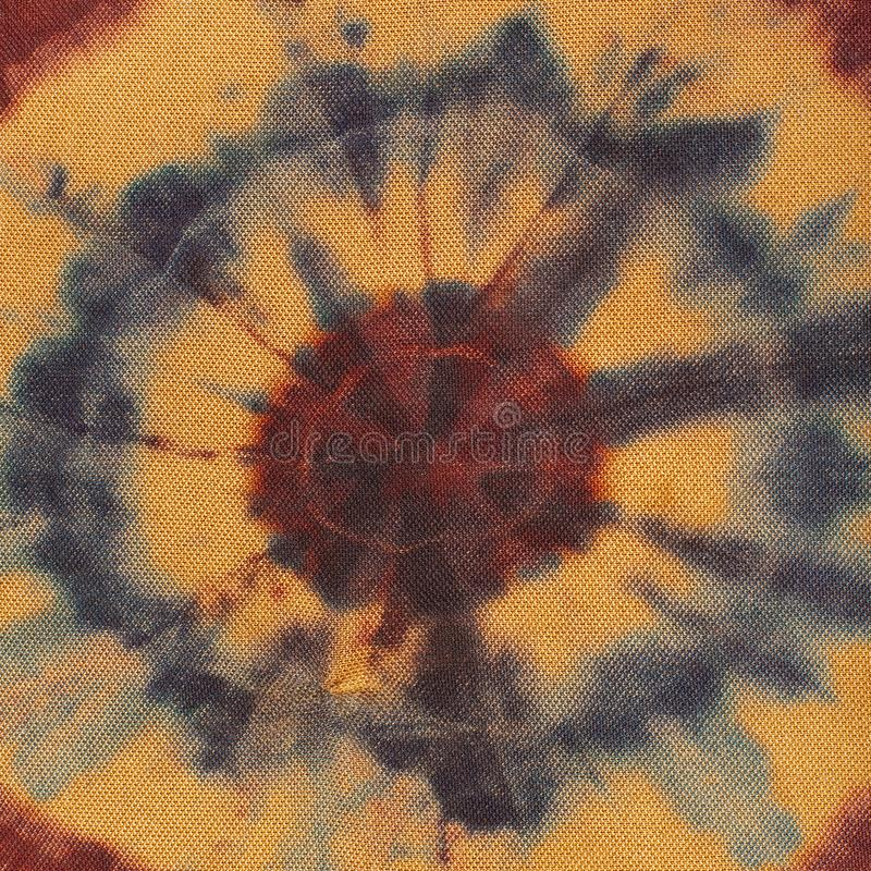 Abstract concentric circles on brown silk batik royalty free stock photography