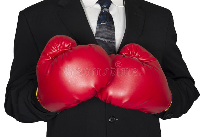 Abstract Concept Business Boxing Gloves Isolated. Abstract business concept. A tough businessman is wearing a suit and tie with boxing gloves. Sales, marketing royalty free stock photo