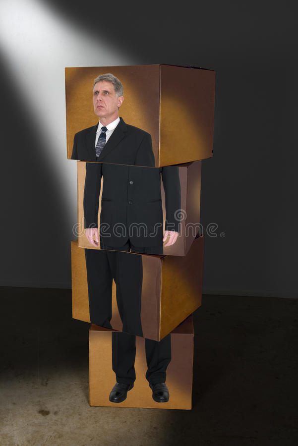 Abstract Concept Business Man For Sales, Marketing. Abstract business concept. Image of a businessman is printed on a stack of cardboard boxes. The picture can stock image