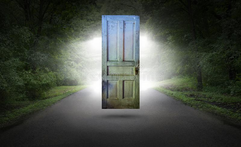 Surreal Door, Road, Highway, Spiritual Rebirth. Abstract concept for spiritual rebirth, hope, mystery, danger, power, and religion. A door floats above a black stock photos