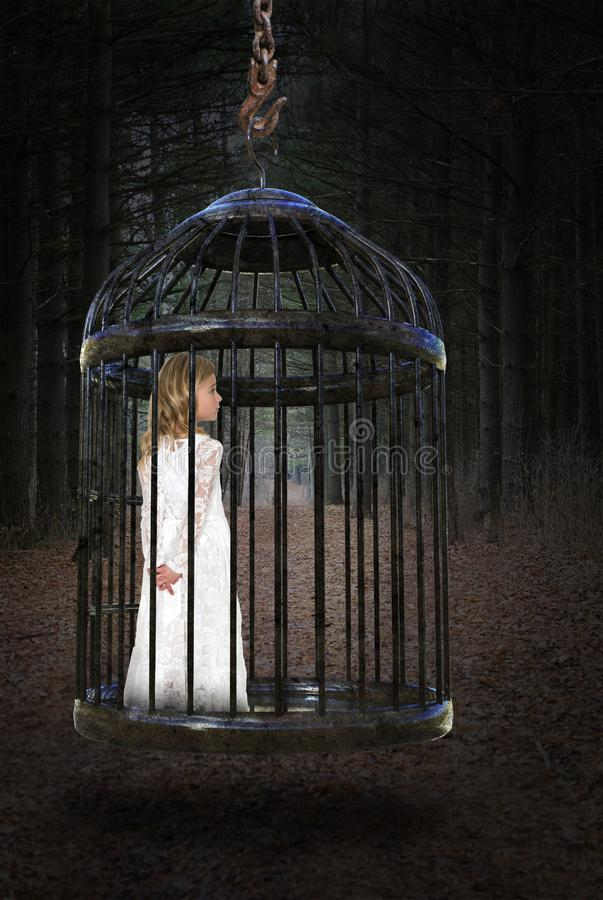 Young Girl, Cage, Love, Hope, Peace. Abstract concept of a young girl trapped in a cage. The child is a metaphor for freedom, peace, hope, and love royalty free stock image