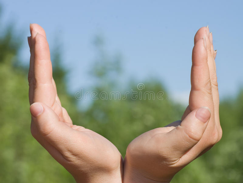 Abstract conception with hands towards sky stock photo