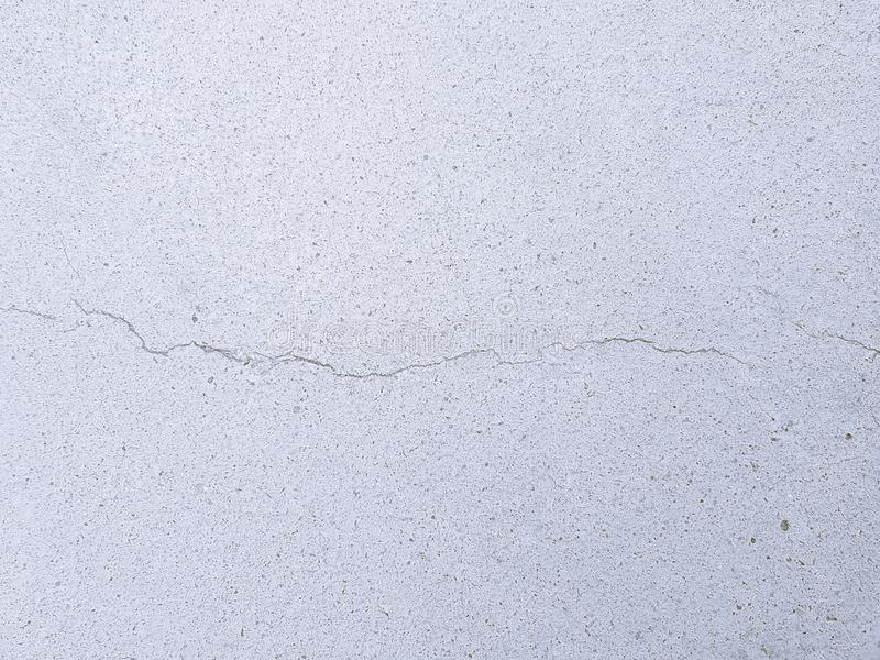 Smooth cracked concrete texture wall - cement background with structural defect royalty free stock image