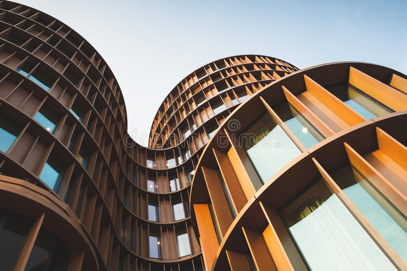 Abstract contemporary architecture photo. Abstract contemporary architecture background, round towers made of yellow shiny metal and glass stock photography