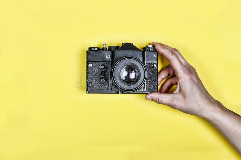 Abstract creative concept, camera, fashion, holding, lifestyle, photo, photographer, vintage.background, stock photo